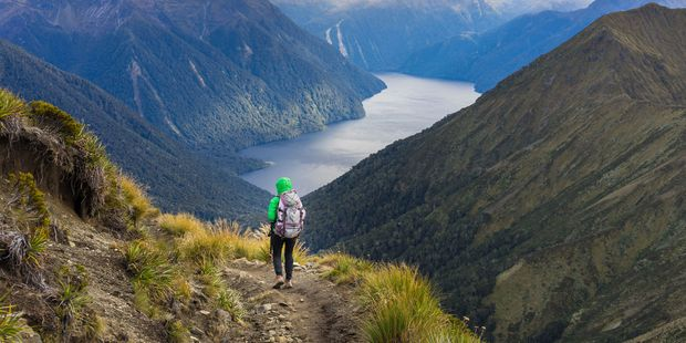 A woman hiking the Kepler Track. More than 60 per cent of tracks on NZ's Great Walks are not up to standard. Photo / Supplied