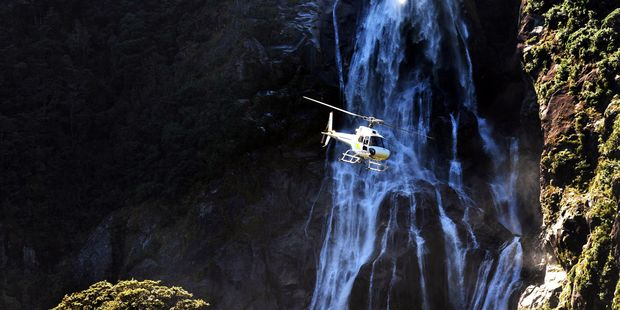 A helicopter flies over Fiordland, New Zealand. Photo / 123RF