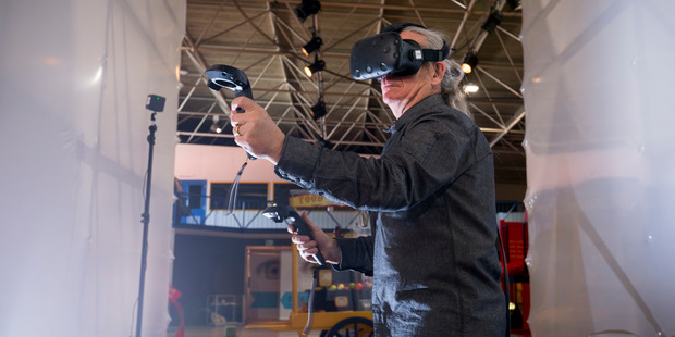 Stunt director Guy Norris playing a game using HTC Vive. Photo / Dean Purcell