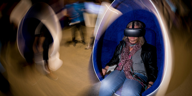 Documentary Editor Miriama Toms try's out the Samsung VR set-up during the virtual reality conference held at MOTAT. Photo / Dean Purcell
