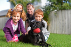 Mia the dog has a home. Craig and Jana Bennett with children Dominik, 9, and Andrejka, 6. Photo/George Novak