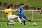 Tauranga City United's Harry Gawtrey (blue) beats Eastern Suburbs' Hayden Johns to the ball during Sunday's Northern Premier game at Links Avenue. Photo / George Novak