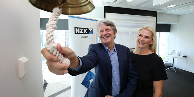 AFT Pharmaceuticals Managing Director Hartley Atkinson rings the bell to signal his company sharemarket listing on the NZX, with wife Maree Atkinson. Photo / Getty Images