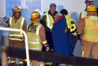 The 38 rescued thrill seekers walk up the stairs of the Roxburgh Rugby Club to eat, drink and be medically checked. Photo / Otago Daily Times