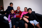 The Tauia family (L-R) Teiliam age 11, Tepora age 5, Matthew (dad), Tuhe (mum) and Marcel age 8 at their home in Massey. Photo / Dean Purcell