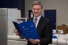 Finance Minister Bill English looking over a copy of his Budget 2016 speech. Photo / Mark Mitchell