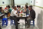 Barack Obama and Anthony Bourdain talk over dinner and a beer in Hanoi. Photo / Twitter