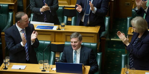 Loading Finance Minister Bill English is congratulated by Prime Minister John Key and fellow National MPs after reading his Budget 2016 in the House. Photo / Mark Mitchell