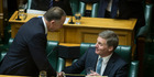 Finance Minister Bill English is congratulated by Prime Minister John Key and fellow National MPs after reading his Budget 2016 in the House. Photo / Getty Images