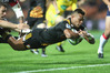 Seta Tamanivalu scores a spectacular try for the Chiefs against the Melbourne Rebels last Saturday. Photo / Getty Images
