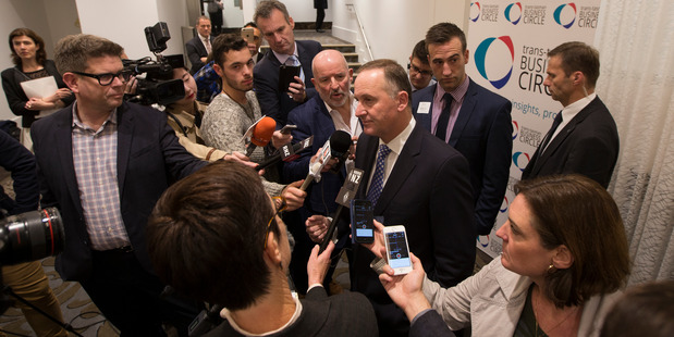 Loading Prime Minister John Key during a stand-up for media in Auckland today.  Photo / Brett Phibbs