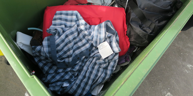Discarded excess clothing stock has been slashed and thrown out. Photo / Nicole Barratt