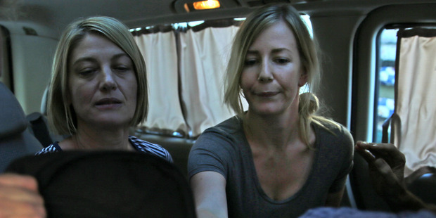 Australian TV journalist Tara Brown, left, and Sally Faulkner, right, the mother of the two Australian children, sit in a minivan after they were released from a Lebanese jail. Photo: AP