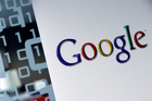The dawn raid is part of a probe into whether the internet giant has evaded corporation tax in France. Photo / AP