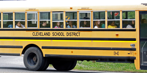 An integrated group of Cleveland, Mississippi, public school students ride the school district bus. Photo / AP