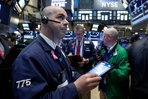 Trader Fred DeMarco, left, works on the floor of the New York Stock Exchange. Photo / AP