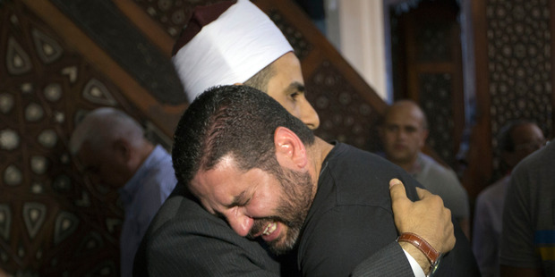 The Imam of al Thawrah Mosque gives condolences to film director Osman Abu Laban who lost four relatives on the EgyptAir plane crash. Photo / AP
