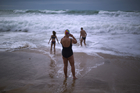 German tourists walk on the seashore at a beach in Cadiz. Photo / AP