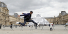 Street artist JR poses in front the Louvre Pyramid in Paris. Photo / AP