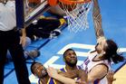Steven Adams dunks over Golden State Warriors forward Harrison Barnes and center Festus Ezeli. Photo / AP