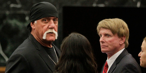 Hulk Hogan, whose given name is Terry Bollea, left, looks on in court moments after a jury returned its decision in his favour in March. Photo / AP