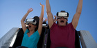 Visitors ride the new Superman The Ride Virtual Reality Coaster at Six Flags New England. Photo / AP