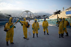 Health workers get ready to spray insecticide to combat the Aedes aegypti mosquitoes that transmits the Zika virus in Rio de Janeiro. Photo / AP