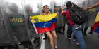 Around 1.85 million Venezuelans have signed a petition to recall the president, Nicolás Maduro, but that may still not be enough. Photo / AP