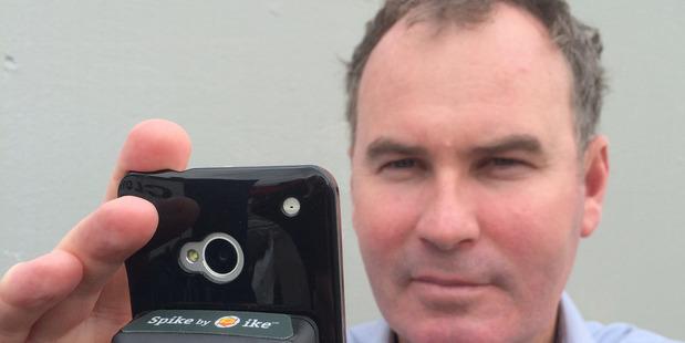 IkeGPS CEO Glenn Milnes holds the company's Spike smartphone measuring tool. Photo / File