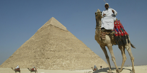 Loading A camel driver touts for business at the great pyramids of Giza near Cairo in Egypt. Photo / Alan Gibson
