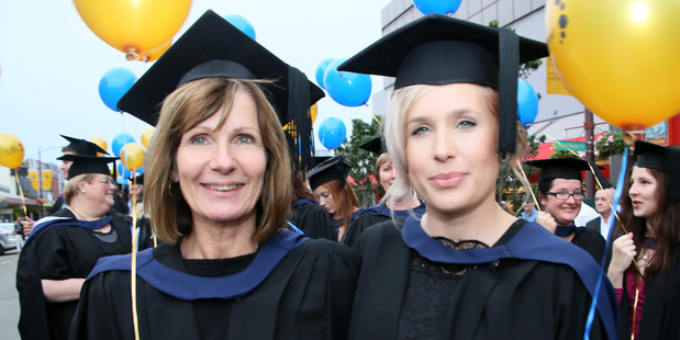 IN THE FAMILY: Andrea Thornton and daughter Hannah Ratcliffe at their graduation. Both women graduated with Masters of Nursing degrees.