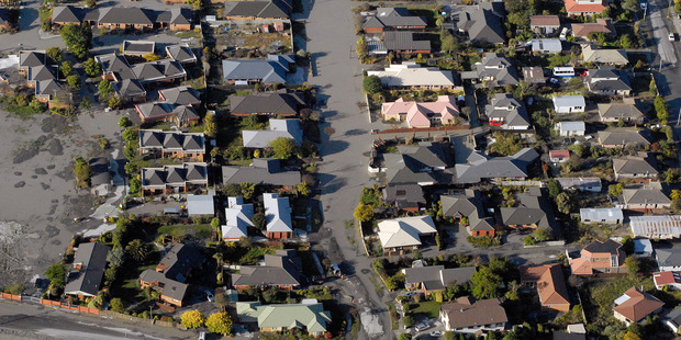 Aerial view of liquefaction and earthquake damaged houses in Christchurch. Photo / Geoff Sloan