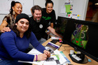 Samara Korewha, front, a student at the Whangarei Design School, is the winner of the Youth Week T-shirt competition, with, from left, Fashion and Textile Design tutor Malia-ana Flavell-Turketo, Hot Printz' Brett Sands and Briarley Birch from Te Ora Hou's The Pulse. Photo / John Stone
