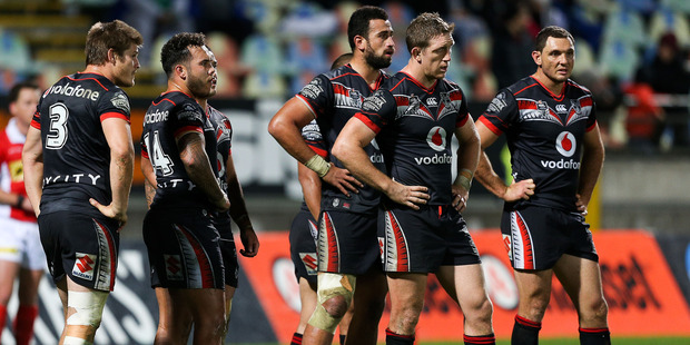 Loading Ryan Hoffman of the Warriors and teammates look on in disappointment after a Raiders try. Photo / Getty Images