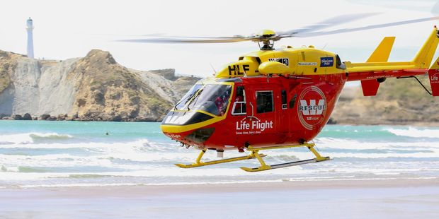 The Life Flight Westpac rescue helicopter setting down at Castlepoint beach. PHOTO/JUDY WAGG