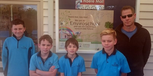 South Featherston School students from Room 3 and teacher Peter Hull with the Enviroschools sign now gracing the school noticeboard. PHOTO/SUPPLIED
