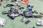 The first images have emerged of debris of EgyptAir flight 804, which crashed into the Mediterranean on its way to Cairo from Paris, killing all 66 people on board. The Egyptian military released pictures Saturday.