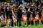 Warriors players look on in disappointment after a Raiders try. Photo / Getty Images.