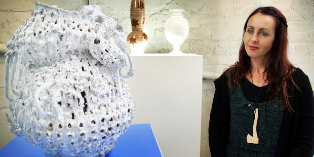 Tree Gallery co-owner Angela Tier with a vase by Andrea du Chatenier.PHOTO/STUART MUNRO