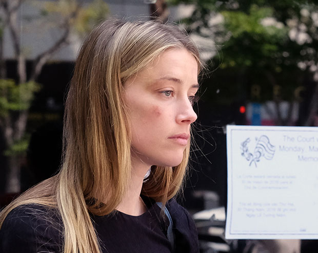 Amber Heard leaves court after giving a sworn declaration that her husband Johnny Depp threw her cellphone at her during a fight, striking her cheek and eye. Photo / AP