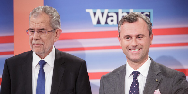 Loading Alexander Van der Bellen, presidential candidate of Austria's Green Party, left, and Norbert Hofer, presidential candidate of Austria's Freedom party. Photo / Bloomberg photo by Lisi Niesner