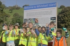 The children from Maungaturoto Primary School celebrate the unveiling of a