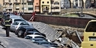 Watch: Watch: 200-metre-long sinkhole buries cars in Florence