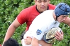 ATTRACTING ATTENTION: Collegiate First XV flanker Reuben Kellow has to deal with three Te Aute College defenders in their game on the No 1 ground. PHOTO/STUART MUNRO