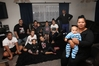 """Brenda Wainohu (front) holding grandson Justin Edwards, says """"more nights than not"""" her extended family come together to share their evening meal. Photo / Duncan Brown"""