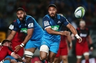 George Moala sends a pass wide to set up the Blues' first try at Eden Park last night. Photo / Photosport