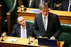 Finance Minister Bill English speaks while Prime Minister John Key looks on during the 2016 budget presentation at Parliament. Photo / Getty Images