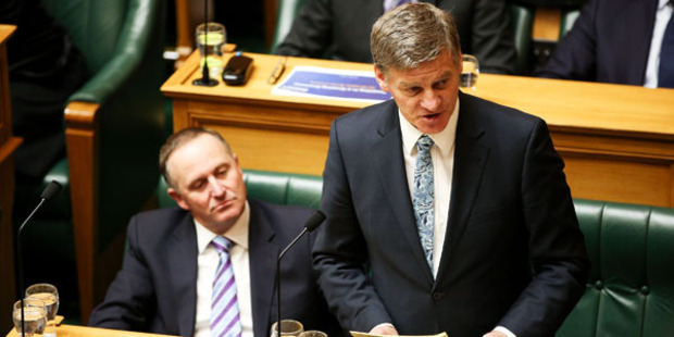 Loading Finance Minister Bill English speaks while Prime Minister John Key looks on during the 2016 budget presentation at Parliament. Photo / Getty Images
