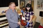 Midge Marsden hands over his Jansen Beatmaster to the Auckland Museum's Jane Groufsky.