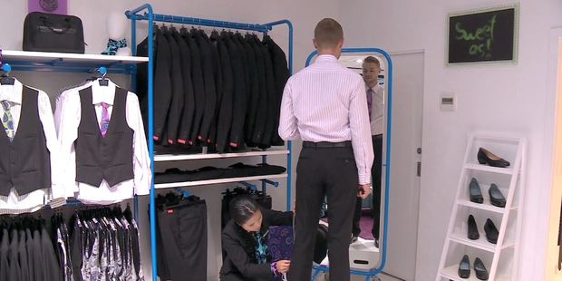 Loading A member of cabin crew is fitted for his uniform. Photo / Air NZ